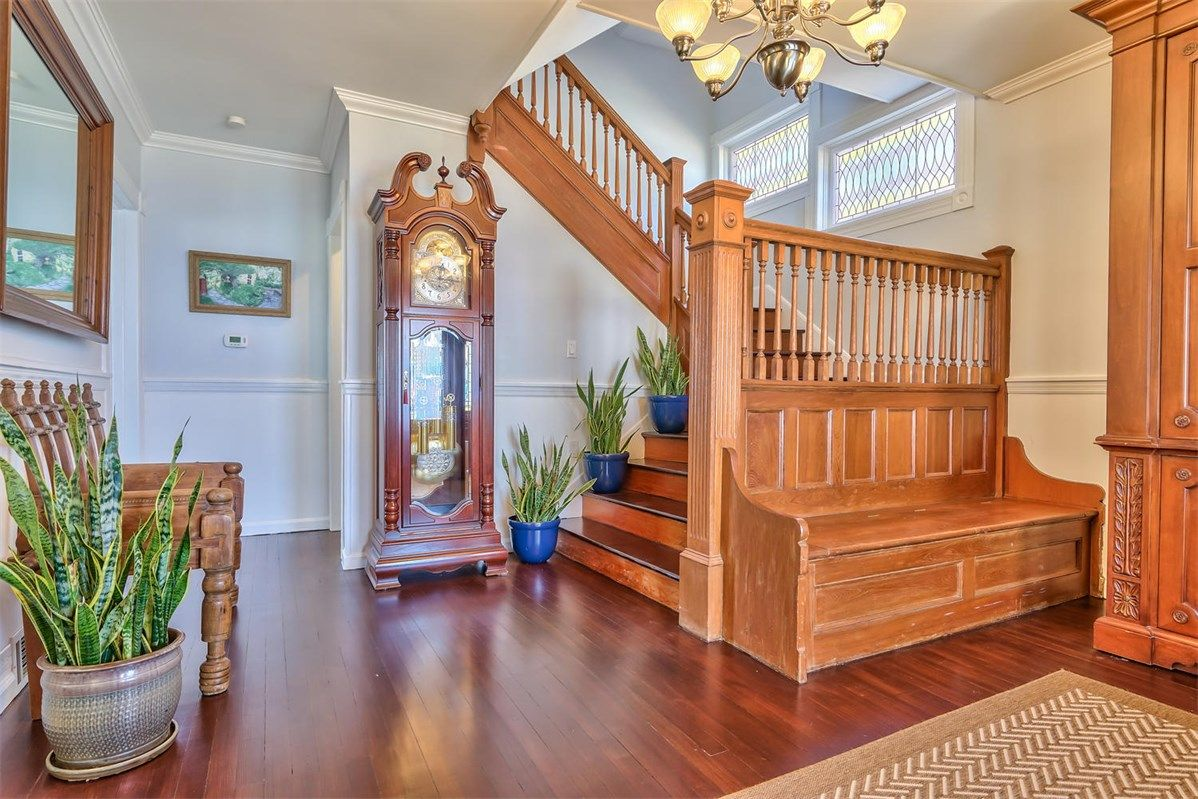 Spacious entry hall with a built in bench provides a place to store your shoes, as well as a place to take them on or off, in this home in Belmar, NJ