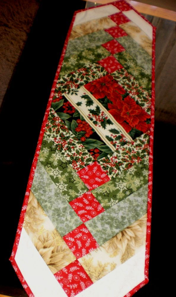 French Braid Christmas table runner, using the quilt as you go technique. Made by Steph Hateley