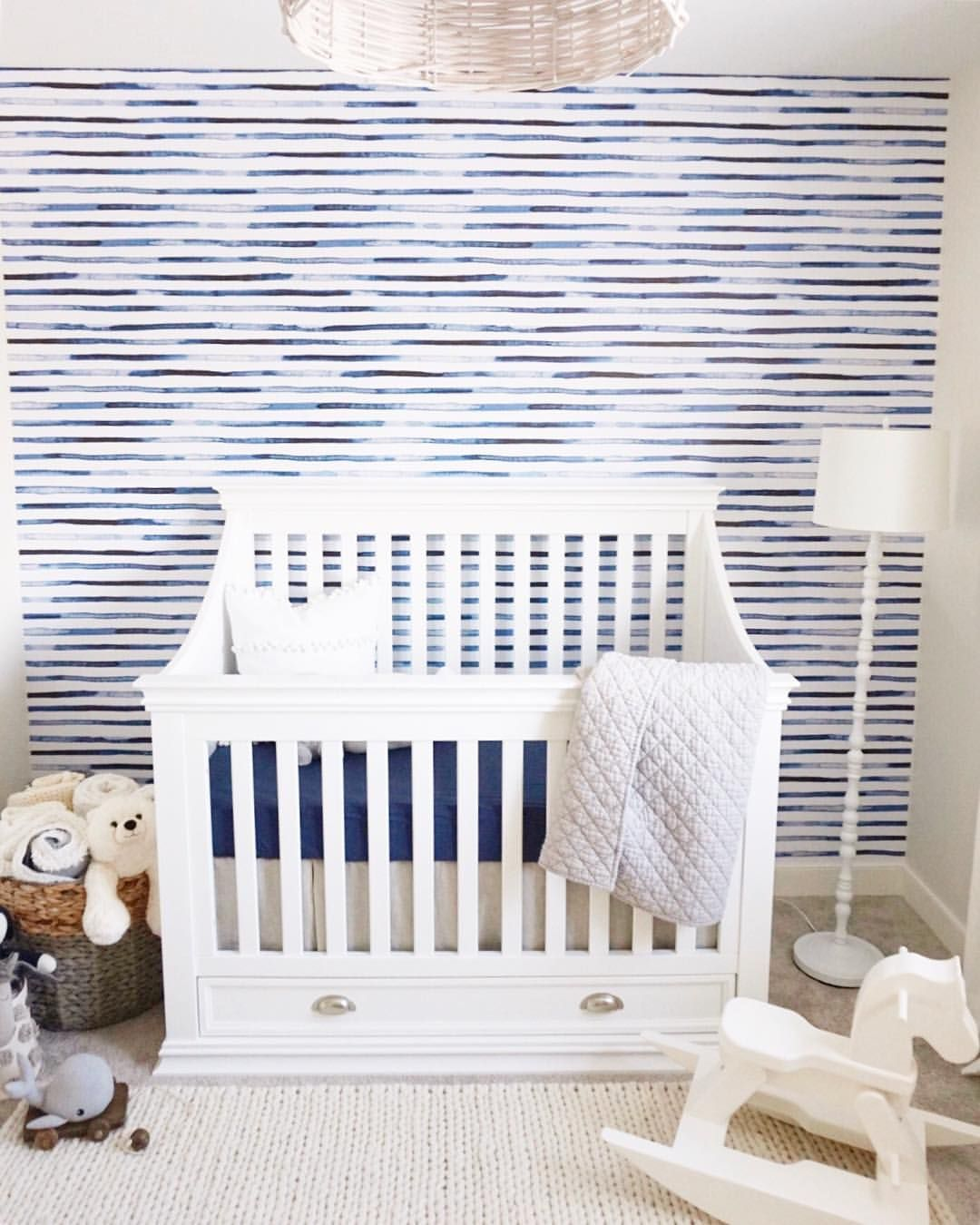 Baby Boy Coastal Nursery White Wood Hanging Light Blue Striped Wallpaper White Mason Franklin And Ben C Baby Nursery Inspiration Baby Boy Rooms Blue Nursery