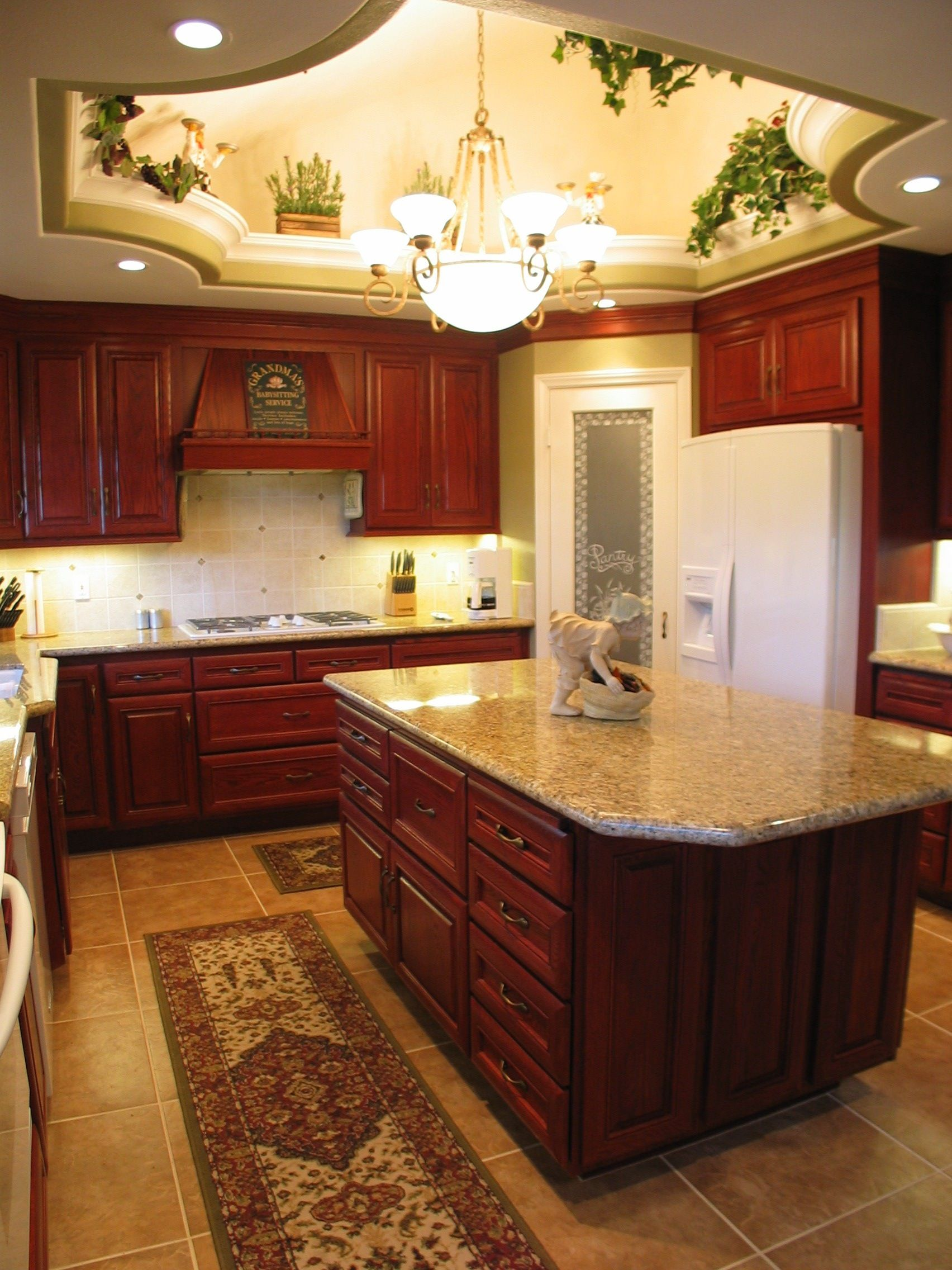 Custom designed kitchen with recessed ceiling, wood ...
