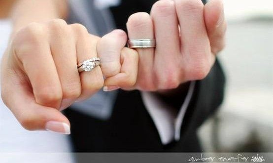 Pinky Promise Showing Off The Wedding Rings