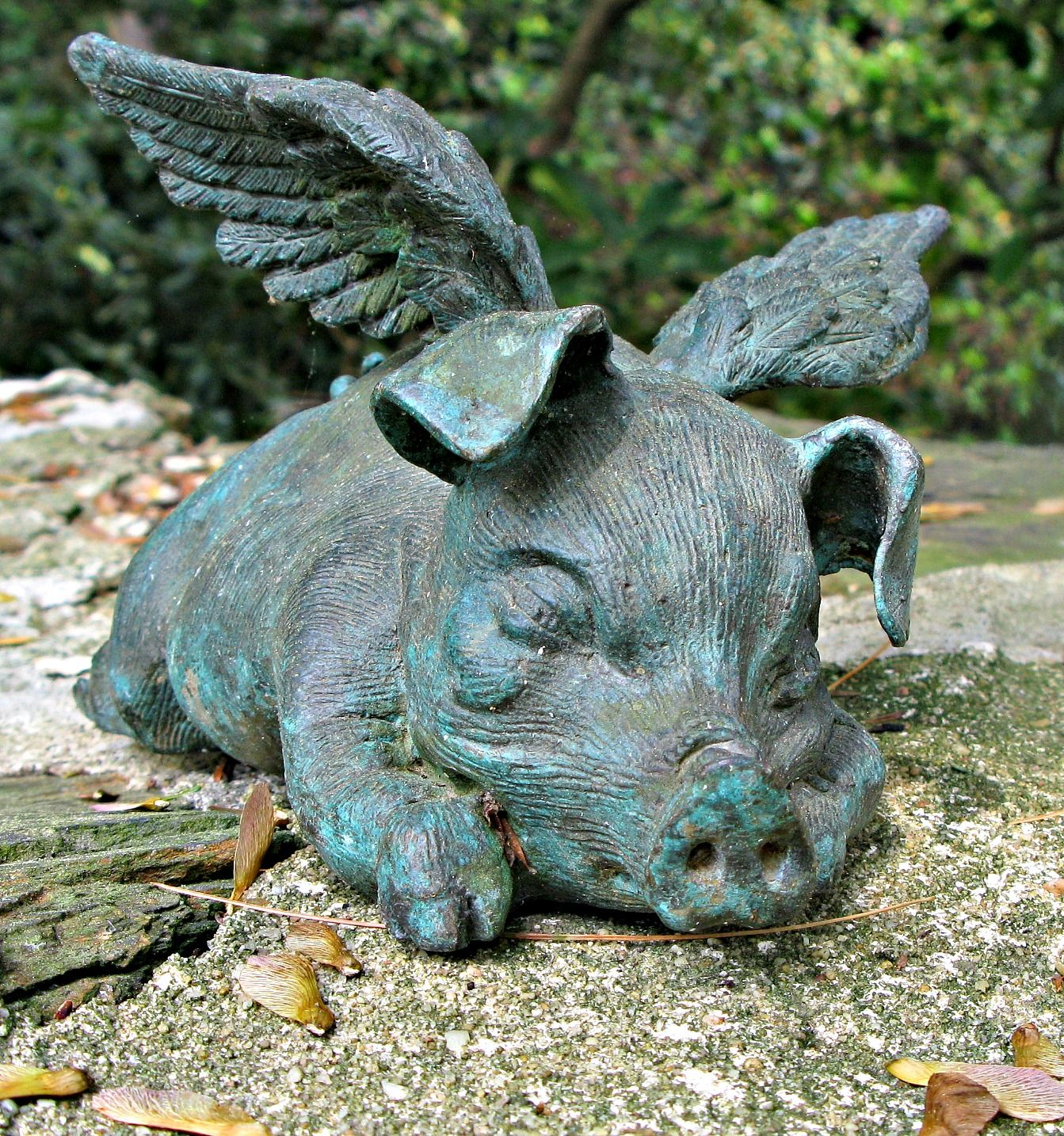 Every Garden Needs At Least One Flying Pig.