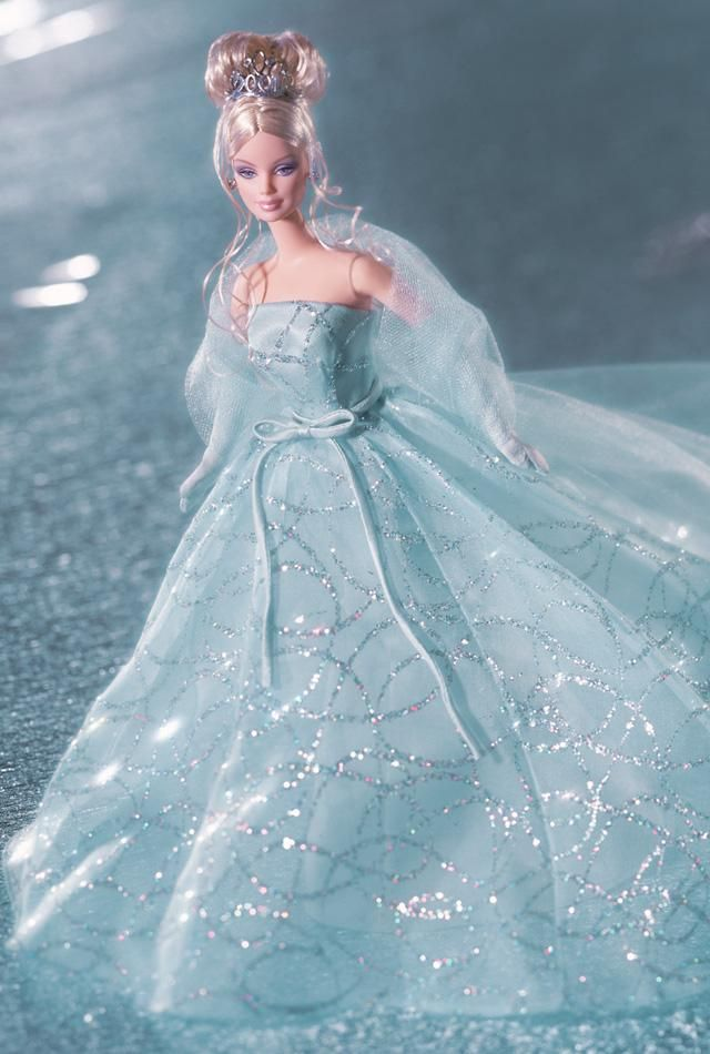 """Second in a series that celebrates the first decade of the new millennium, Barbie® doll looks magnificent in a dazzling organza gown and """"2001"""" tiara."""