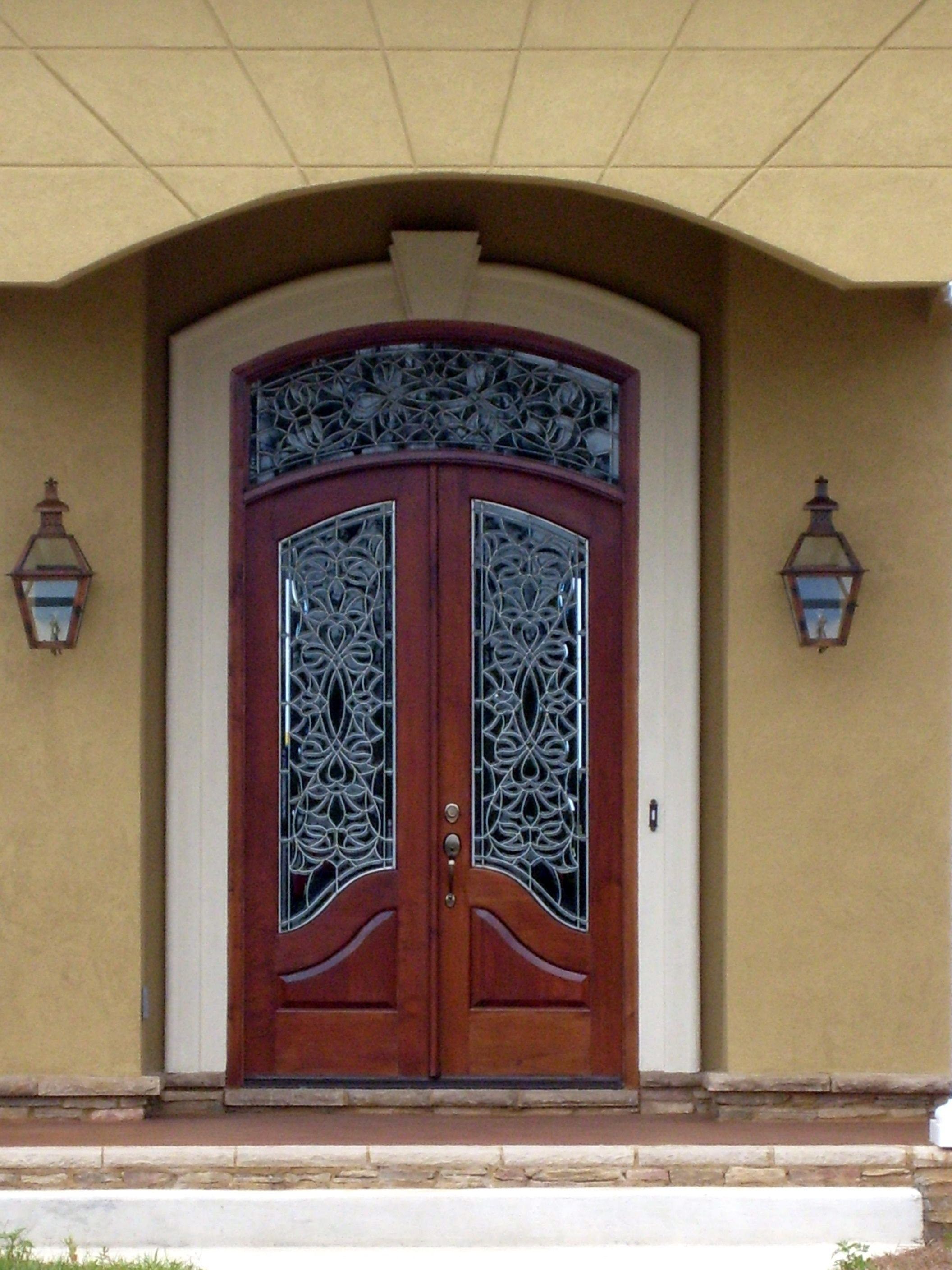 Beautiful custom wood door with leaded glass windows and for Custom transom windows