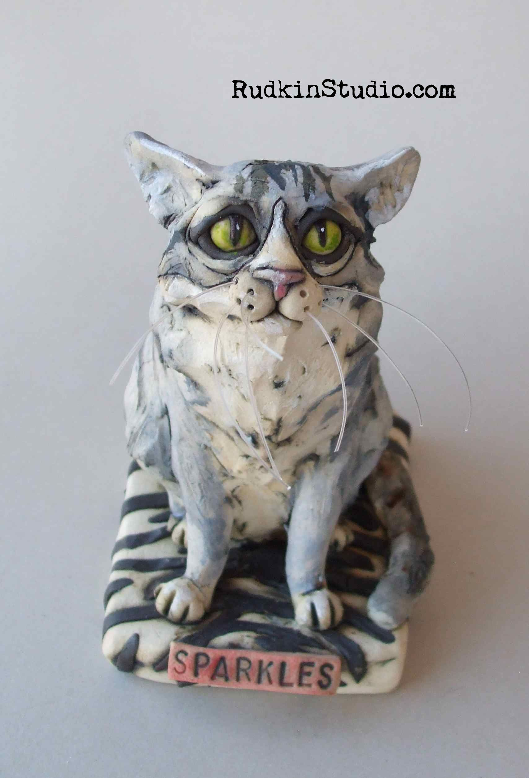 Custom sculpture of a sweet gray cat on her favorite zebra