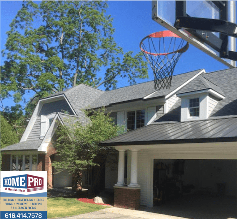 Metal And Asphalt Roofing On Home With Many Levels Roofing Roof Installation Roofing Contractors