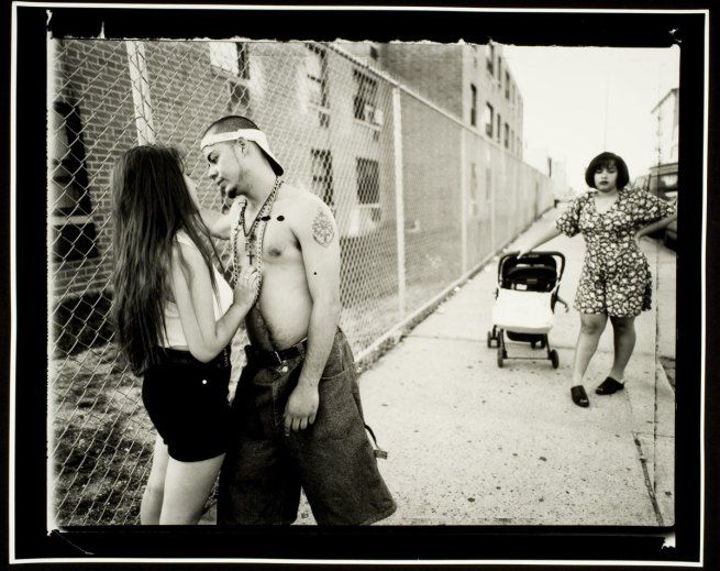 Vincent Cianni (American, b. 1952) 'Anthony hitting on Giselle, Vivien waiting, Lorimer Street, Williamsburg, Brooklyn' From the series 'We ...