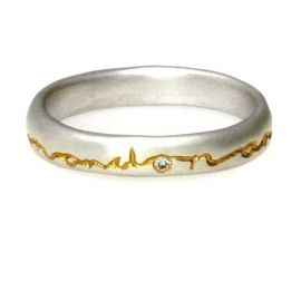 """diana porter - silver & gold wedding ring with words """"and on, and on..."""" single diamond"""