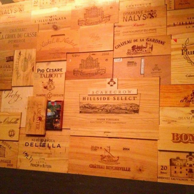 Love this idea of using wine crates as wood paneling for an accent wall