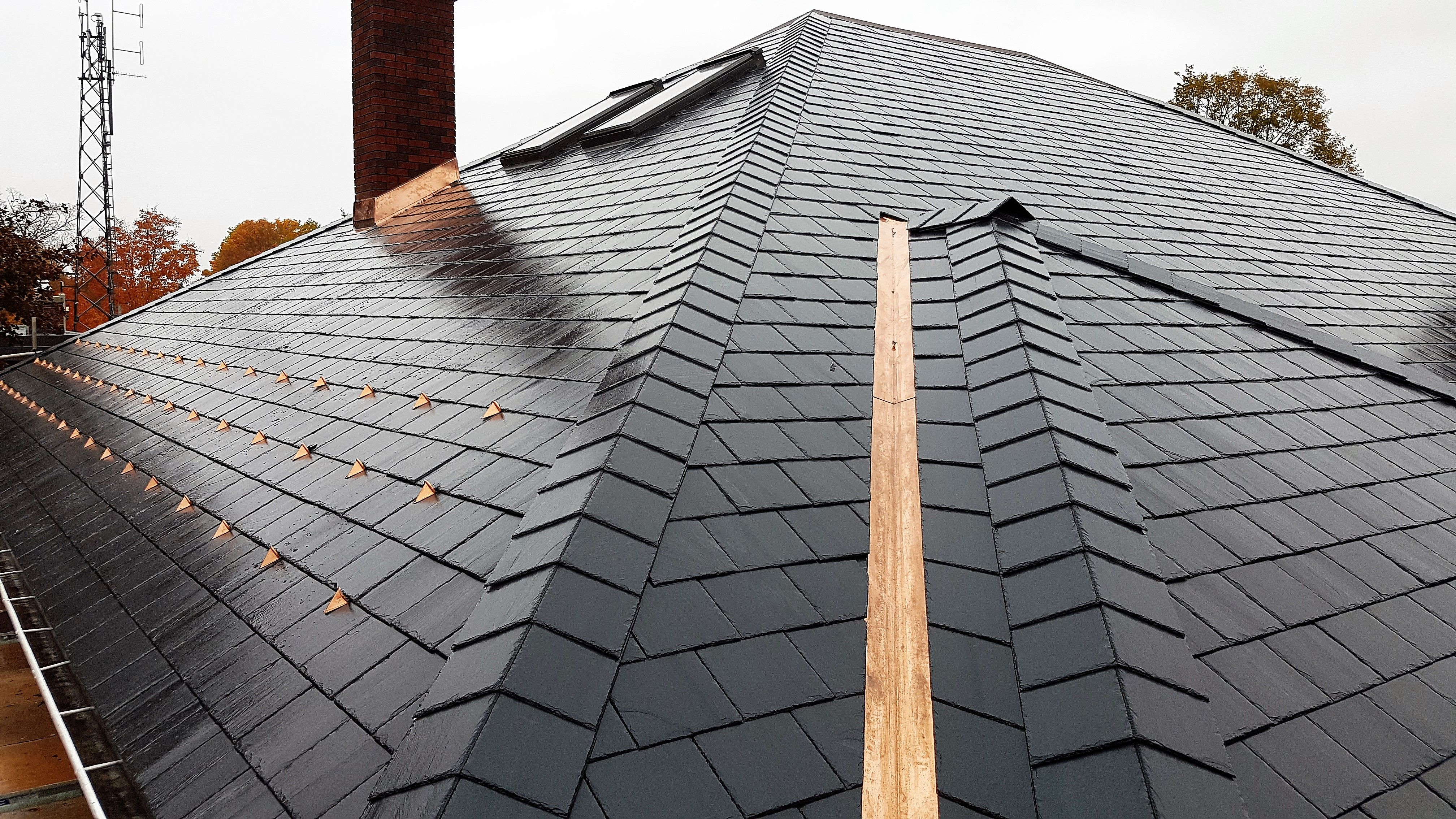 Natural North Country Unfading Black Slate Roof With A Slate Saddle Hip And Copper Snow Guards Roof Installation Slate Roof Slate Roof Installation