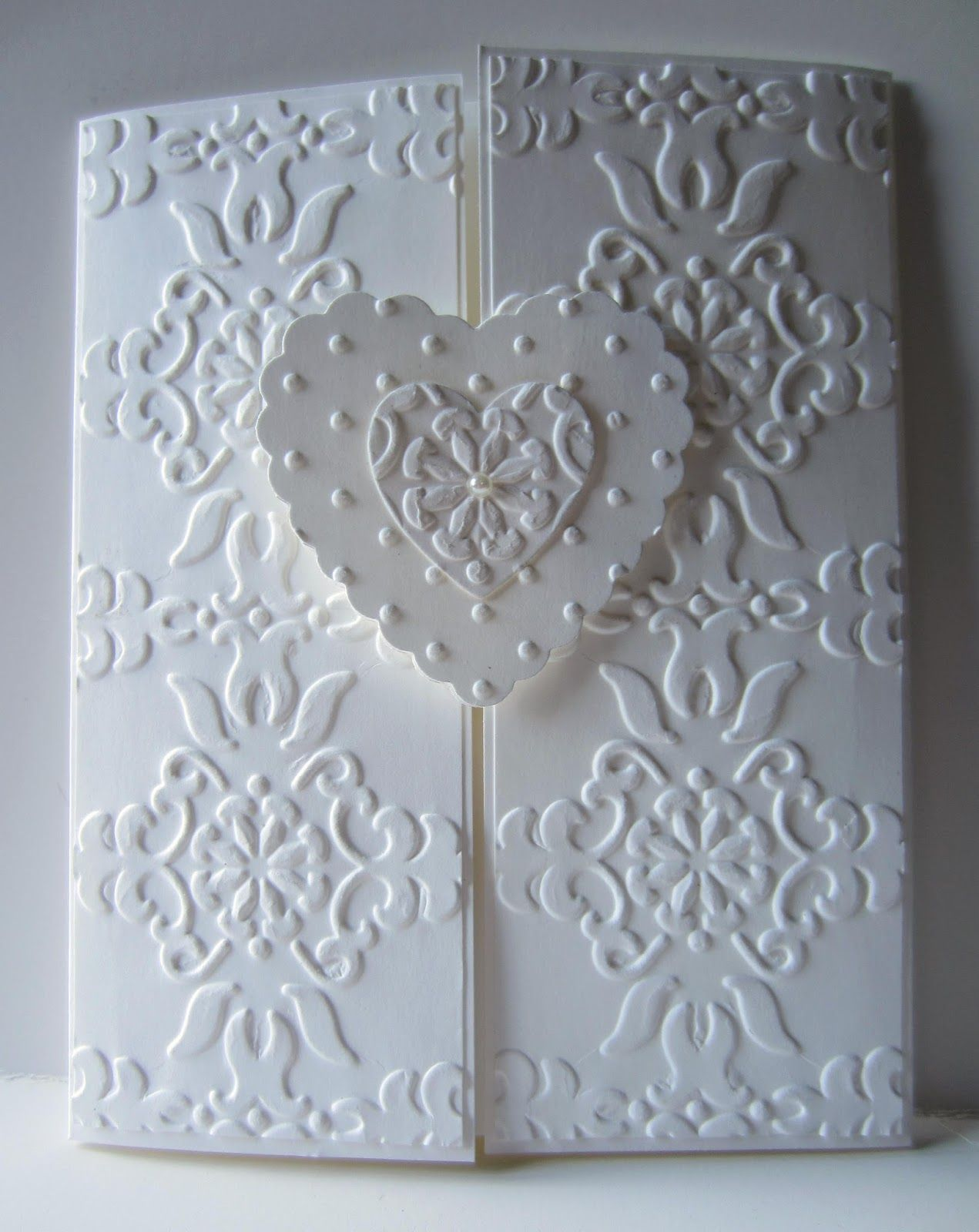 how to emboss wedding invitations diy%0A Gatefold format  white on white  baroque embossing folder texture perfectly  placed on the panels textured hearts  two hearts make one on the closure