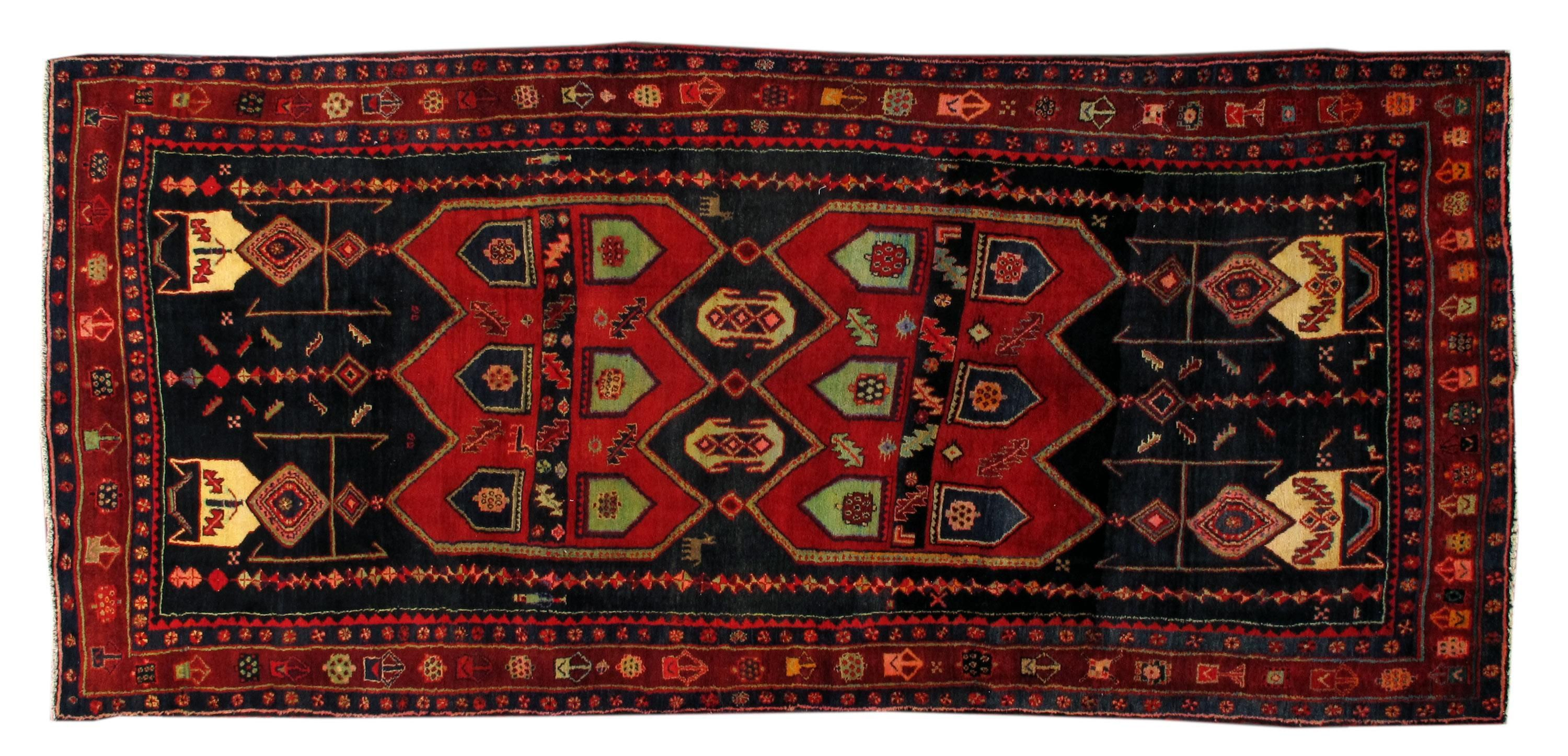 A vintage hand-knotted Persian Bidjar, gallery sized, with an all-over tribal geometric pattern. This gorgeous rug has magnificent detailing in dark red and black colors with cream, green, blue, and orange accents. It would be perfect as a large living room or bedroom area rug!
