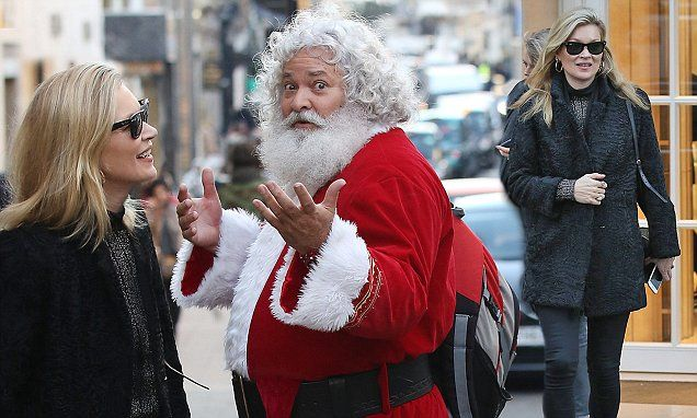 kate moss looks ecstatic as she chats to santa claus in london