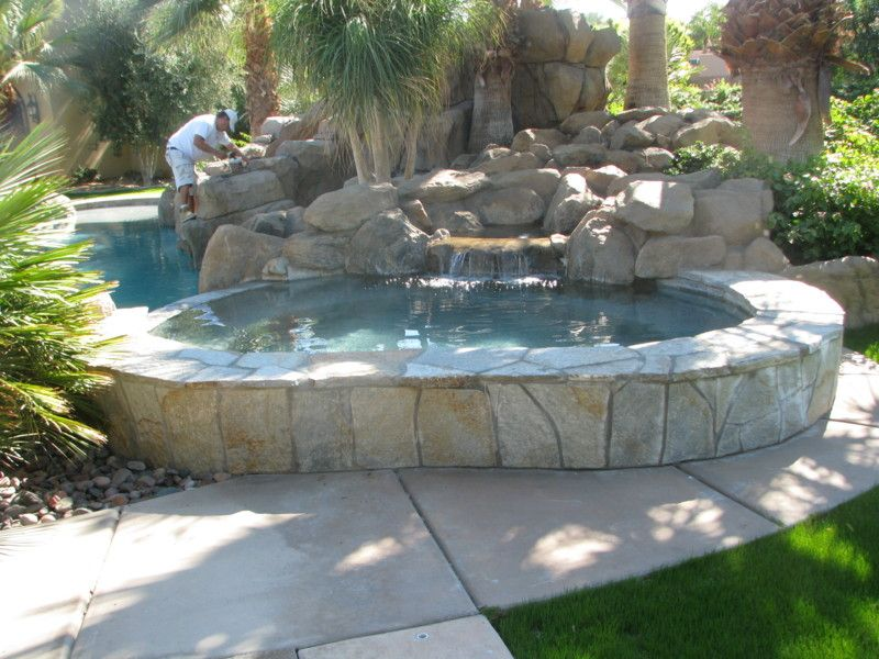 Lovely Kidney Shaped Above Ground Swimming Pools With Stone Designs