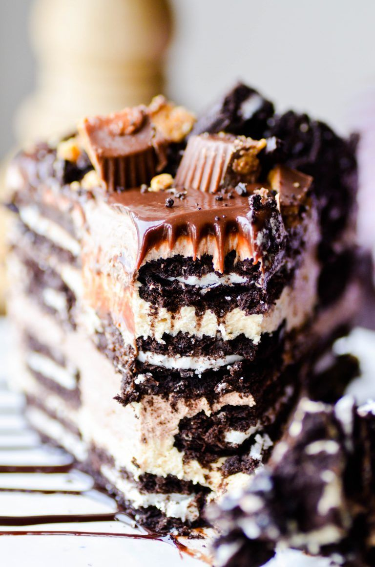 Butter Oreo Icebox Cake LOADS of soft Oreo cookies stuffed in between layers of chocolate and peanut butter mousse topped with hot fudge and peanut butter cups.LOADS of soft Oreo cookies stuffed in between layers of chocolate and peanut butter mousse topped with hot fudge and peanut butter cups.