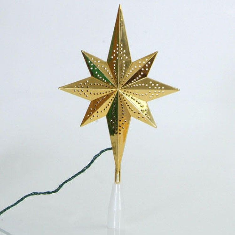 This beautiful shiny gold star tree topper lights my way into