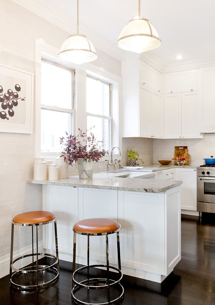 White kitchen design with built in breakfast counter pamela dailey