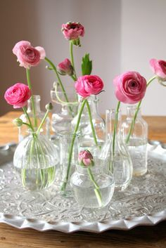 Floral Arrangement ~ vignette of pink ranunculus in assorted clear vases, jars <3                                                                                                                                                      More
