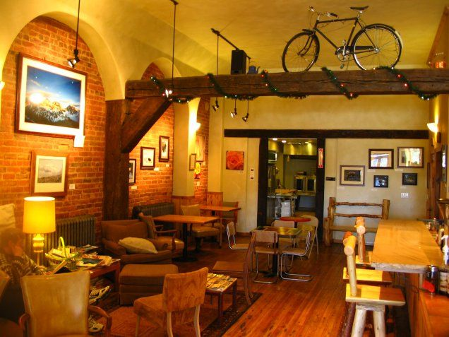 Proving Ground Cafe in Leadville, Colorado (coffeenerds.com). Pinned this because of the bike, and garland beneath.