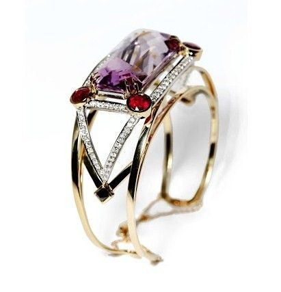 Ara Vartanian, cuff in yellow gold with kunzite, ruby and and white and black diamonds.