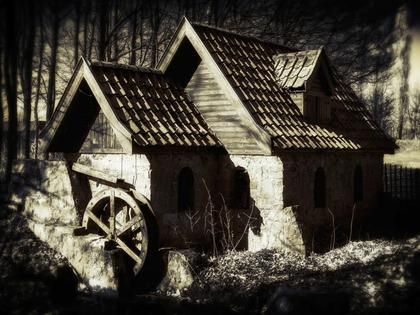 Stone House With Water Wheel by contributor Wim Lanclus