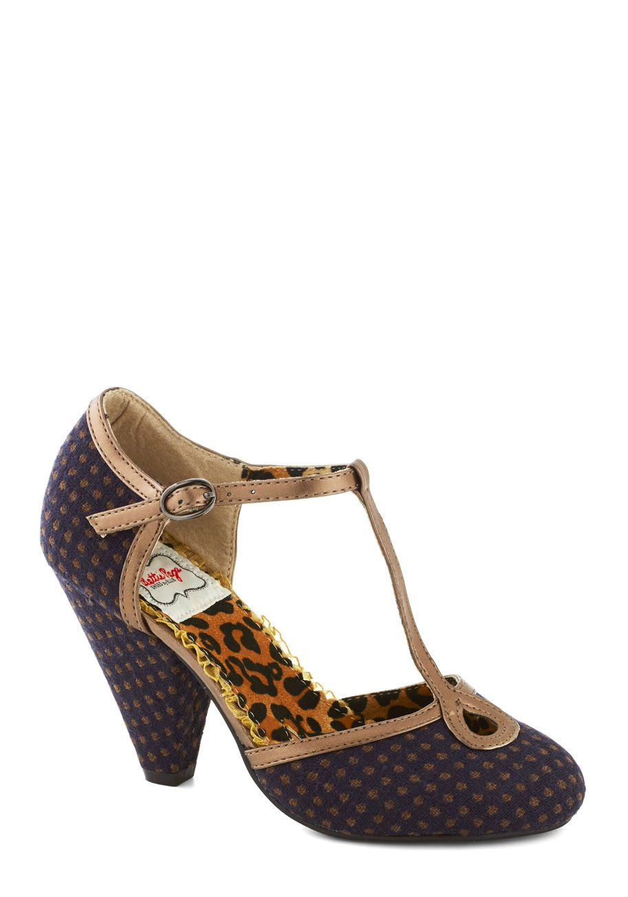 Glam Grammarian Heel. Just as you pluck errors out of essays, you kick fashion foibles out of the picture with the cone heels of these woven navy T-straps by Bettie Page! #blue #modcloth