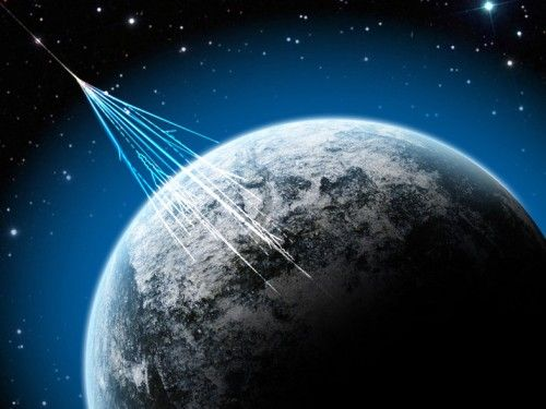 Artist's concept of cosmic rays striking Earth's atmosphere and creating a shower of secondary particles.  Researchers on Earth observe the secondary particles in order to study cosmic rays, which cannot penetrate Earth's atmosphere.  Image via J. Yang / NSF