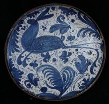Spanish blue and white tazza, Teruel (1650-1700) , decorated with a leaping hare on a ground of stylised flowers and insects with smaller scrolls and tendrils , diameter: 9 in. 23cm.