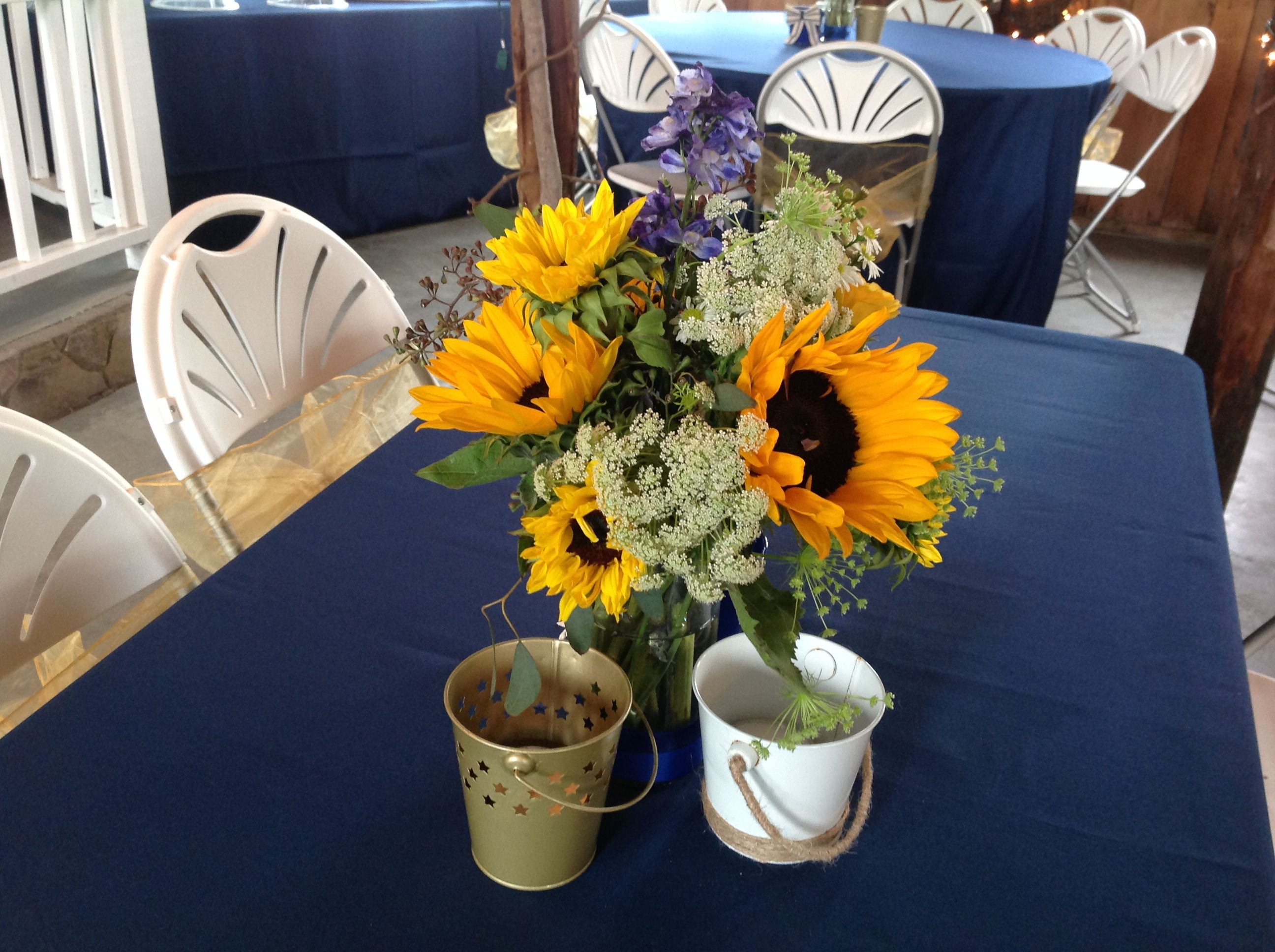 Gold and blue centerpiece by fay event flouret raleigh