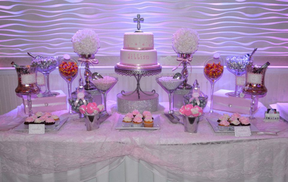 pink and white communion candy buffet table