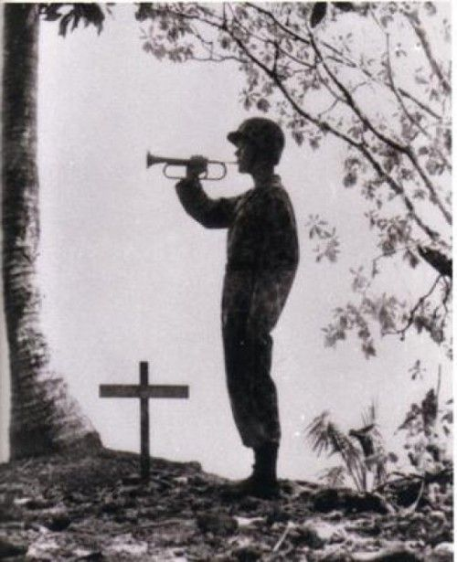 Taps for a fallen comrade on Cape Gloucester