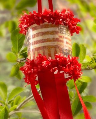 "•Mod Podge® Matte- 8 oz.  •2 Liter Soda Bottle- Clear  •Scrapbook Paper- Flag Design  •Craft Knife  •Straight Edge Ruler  •Red Ribbon- 1½""  •Red Ribbon- 3/8""  •Stapler  •Paper Trim- Red  •Hot Glue  •Scissors"