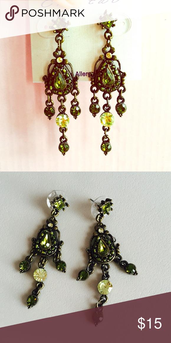 Emerald crystal chandelier Earrings Gorgeous Emerald and light green colored crystal earrings. Chandelier style. Jewelry Earrings