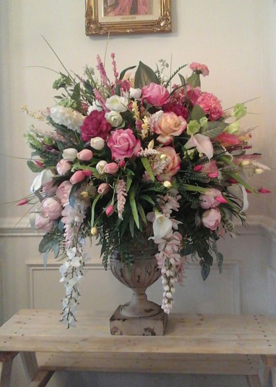 XL LUXURY REAL TOUCH FLORAL ARRANGEMENT SHIPPING INCLUDED This arrangement is made with high quality real touch roses, carnations, several colors of cala lilles, small real touch tulips. The wisteria, zinnias, blossoms, delphinium other decorative filler and beautiful greenery