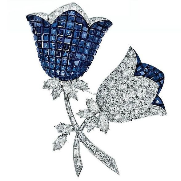 "A ""mystery-set"" sapphire and  diamond  flower brooch, by Van Cleef & Arpels. Photo: Christie's Images Ltd 2012 Designed as two calibré-cut sapphire and circular-cut diamond flower blossoms, with baguette and marquise-cut diamond accents, to the baguette-cut diamond stems and marquise-cut diamond leaves, mounted in platinum and 18k gold, 1967, with French assay marks and maker's marks. Signed Van Cleef & Arpels, no. 18354"