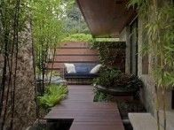Intimate seating areas can be found nestled throughout Jennifer Aniston's Beverly Hills garden