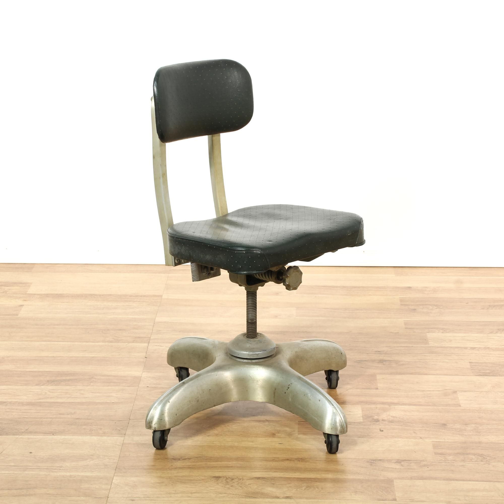 """This """"Art Metal Construction pany"""" chair is featured in a"""