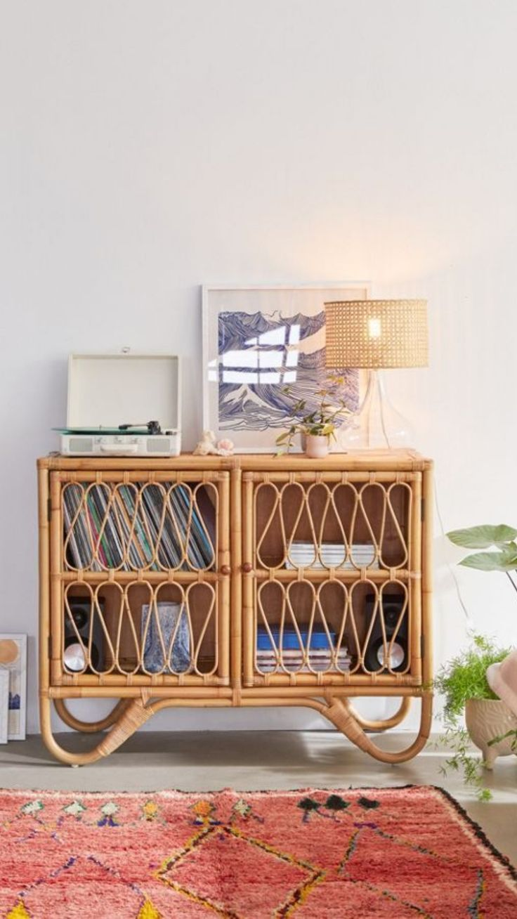 Store your favorite treasures records crystals and more in this rattan cabinet offering vintagelook boho vibes with the prettiest design details 2door cabinet features ra...