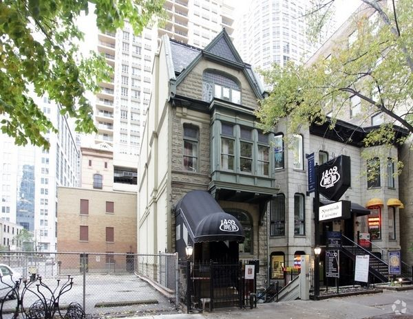 A venture planning to build a tower with hotel rooms and luxury apartments paid $3 million for property at the corner of Wabash and Superior that includes this historic low-rise building at 42 E. Superior St. Photo by CoStar Group