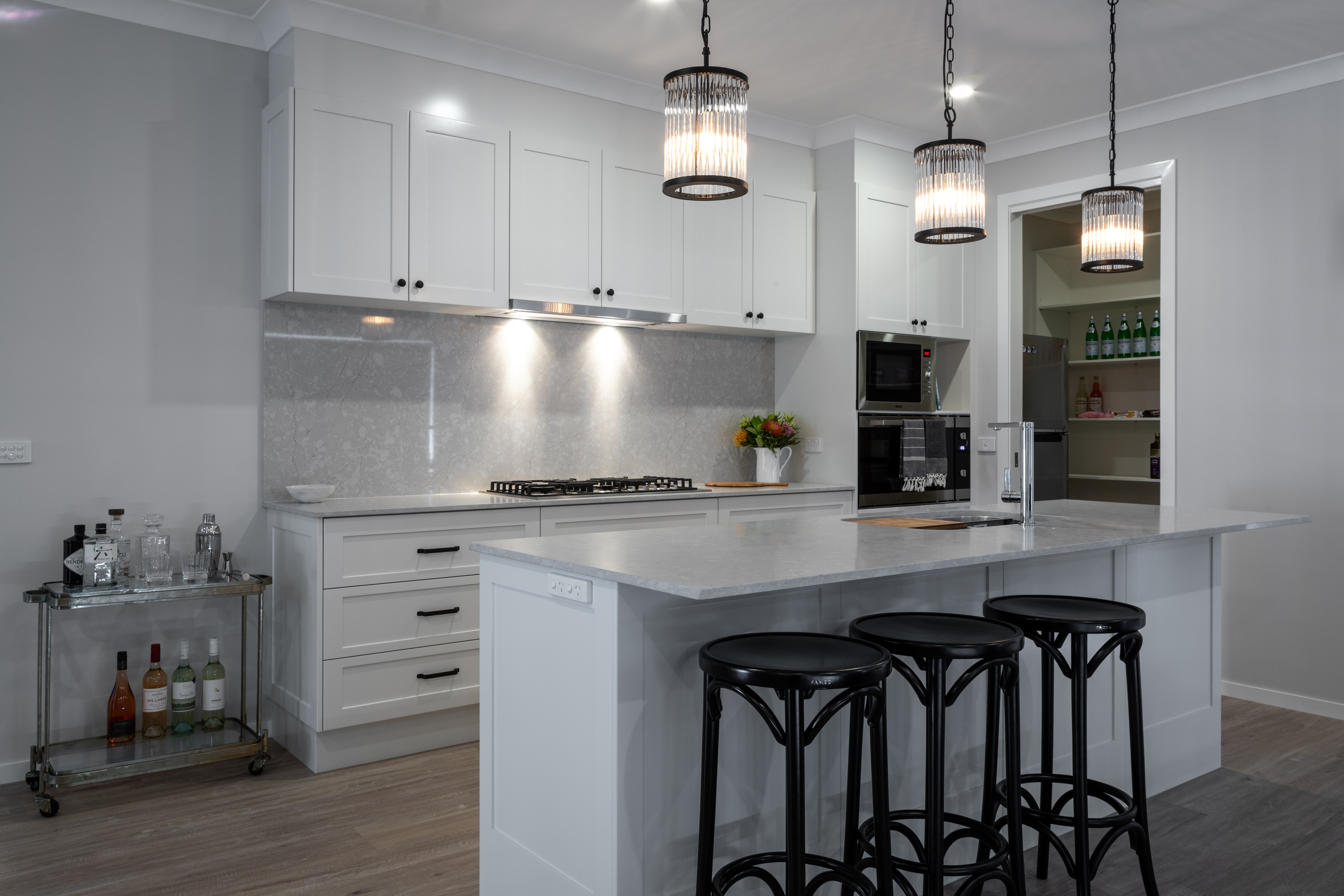 Give Your Kitchen Some Extra Flair With Stunning Pendant Lights Above Your Breakfast Bar Or Island Bench Display Homes Beautiful Kitchens Kitchen Benches Kitchen breakfast bar pendant lights