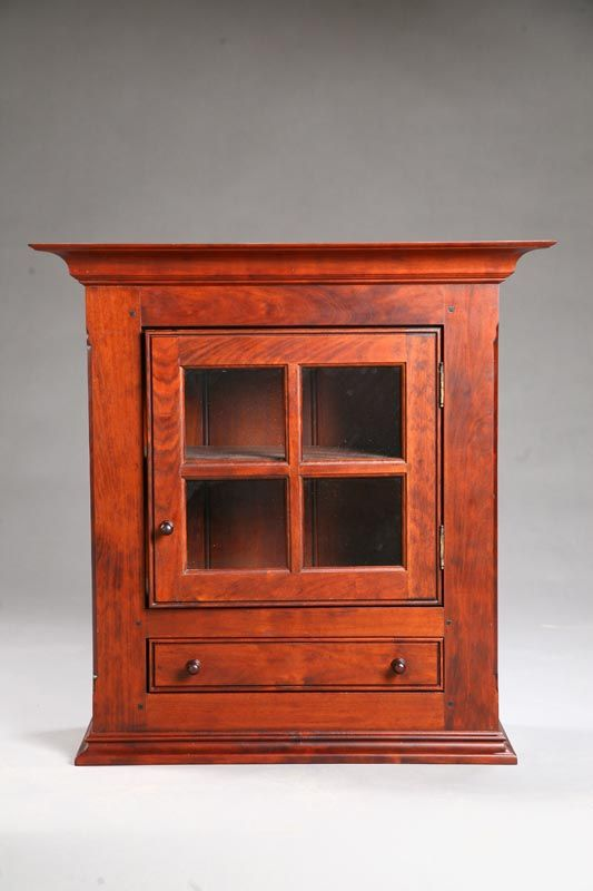 Hanging Cupboard, cherry and poplar, dovetailed case with a four-paine door and a single drawer, 28.75 H. x 28 W. x 11 D.