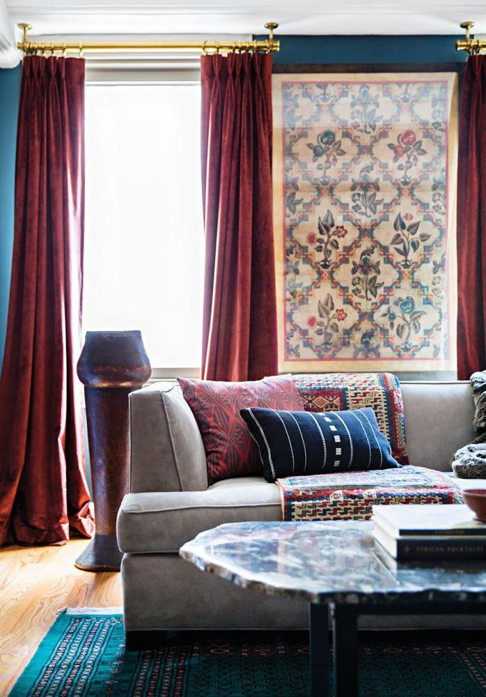 living room with teal blue walls and dark red velvet ...