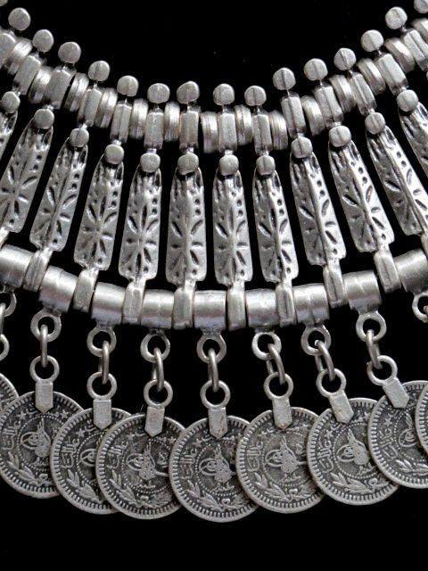 Turkish Spirited Coin Jangle Necklace. I love the idea of each of these jangles being separate and having them for each person of an agency or group.