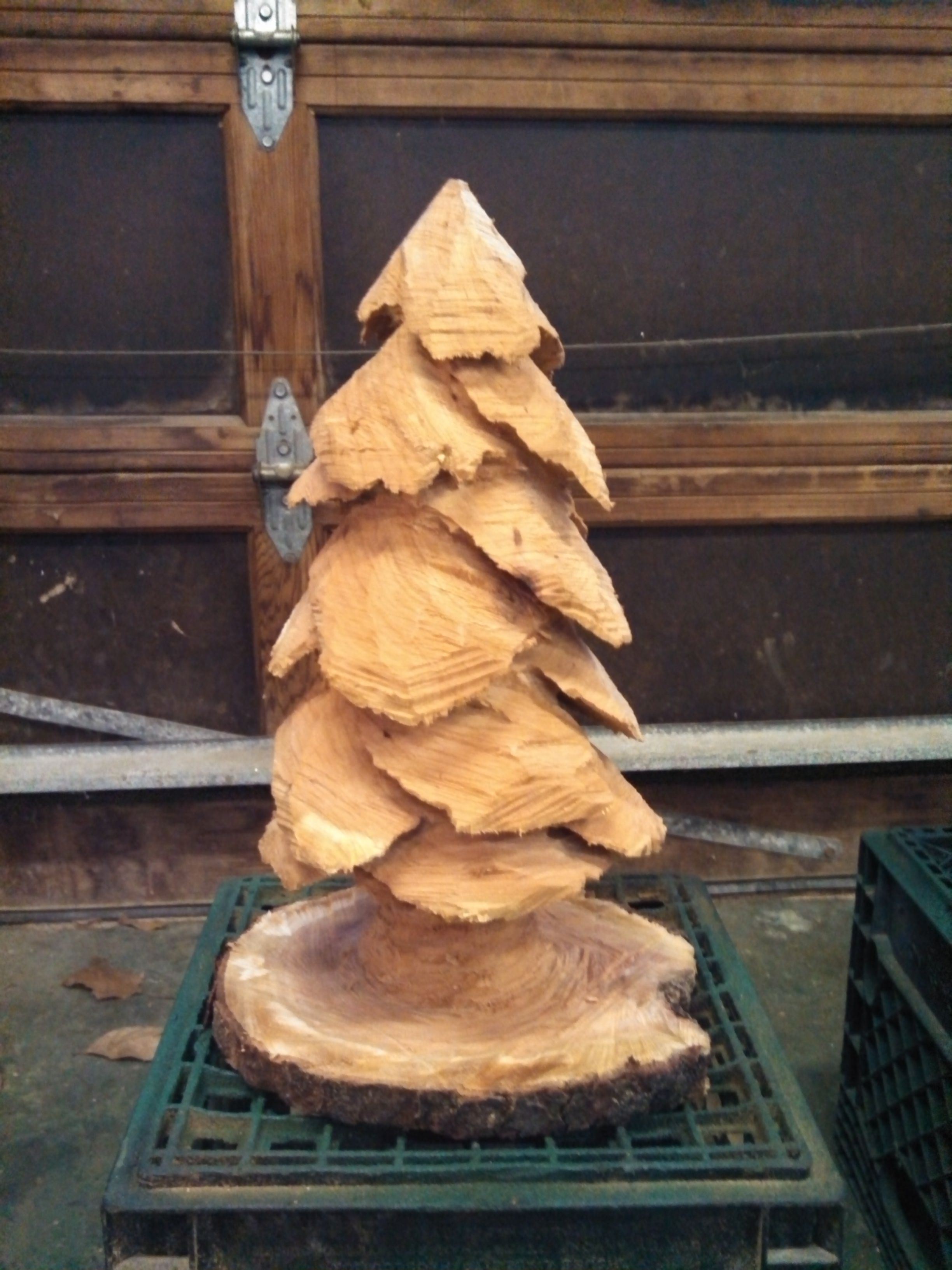 Chainsaw Christmas tree, sealed natural or paint then add tiny lights.