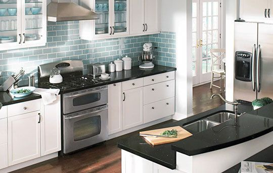 White Cabinets Black Countertop Blue Backsplash