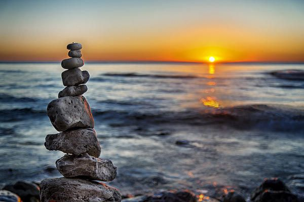The sun rises over a single stone cairn on a Lake Michigan beach at Cave Point County Park in Jacksonport, Door County, Wisconsin.    You can purchase a print of this image and many more here: http://fineartamerica.com/featured/cairn-at-sunrise-scott-norris.html  Copyright 2014 Scott Norris Photography www.scottnorrisphotography.com