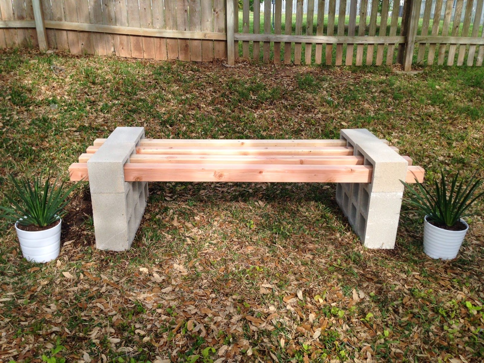 Diy cinder block bench project 12 cinder blocks and 4 4 x4 s make for a quick outdoor bench Yard bench