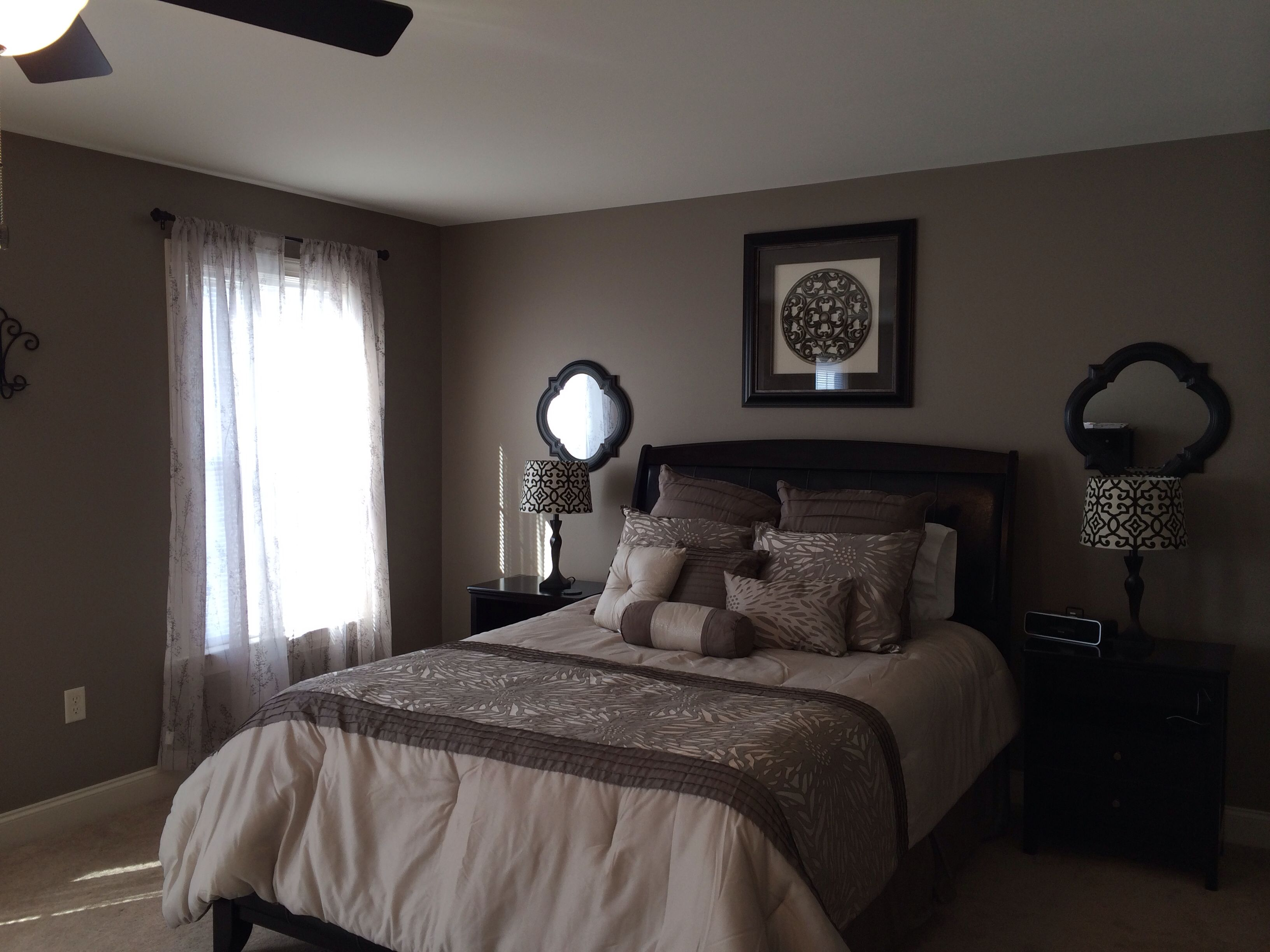 My greige bedroom. Added mirrors behind the nightstands ...