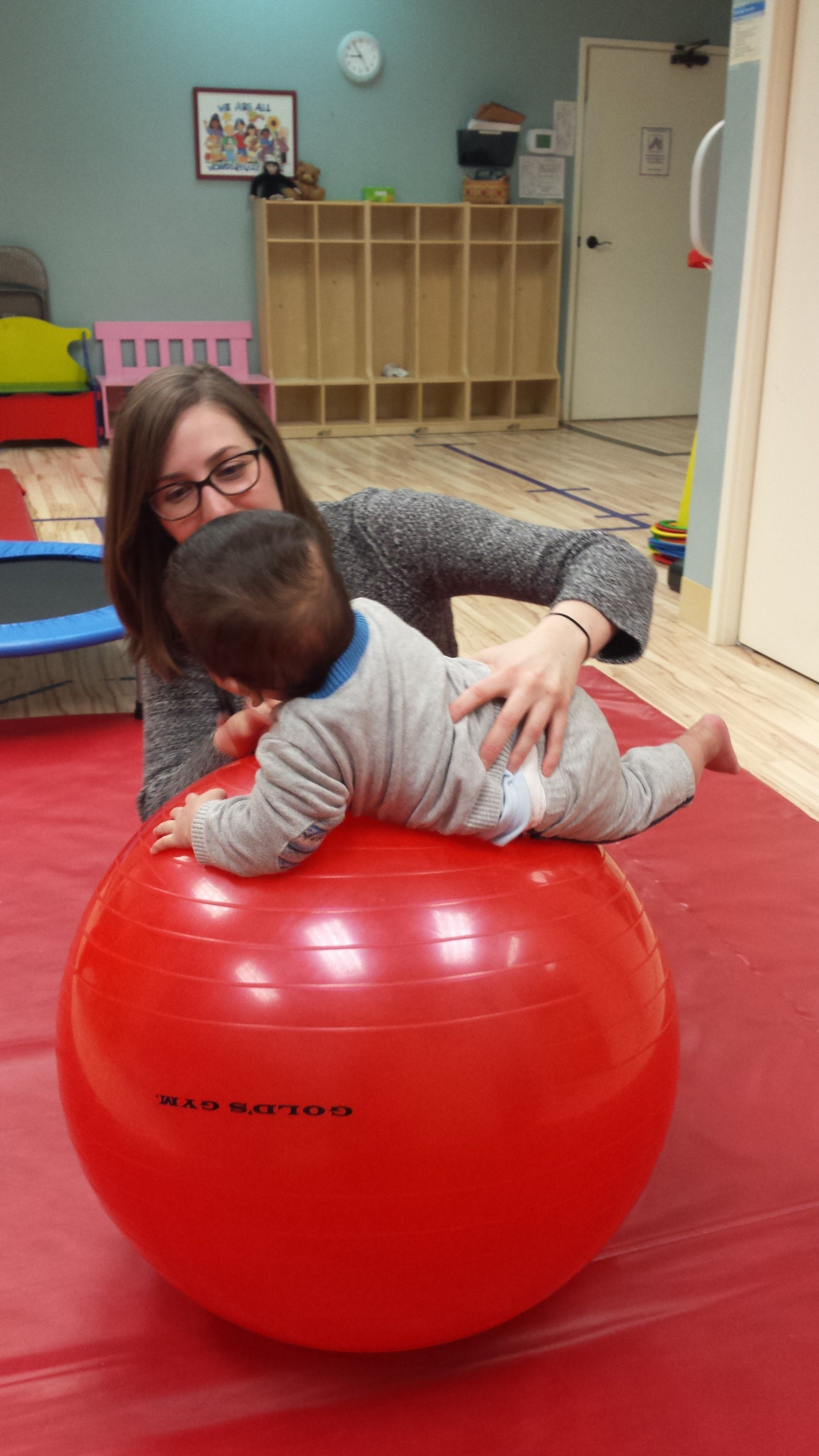 Physical Therapy For Infant Developmental And Torticollis Treatment Often Includes Playtime On A