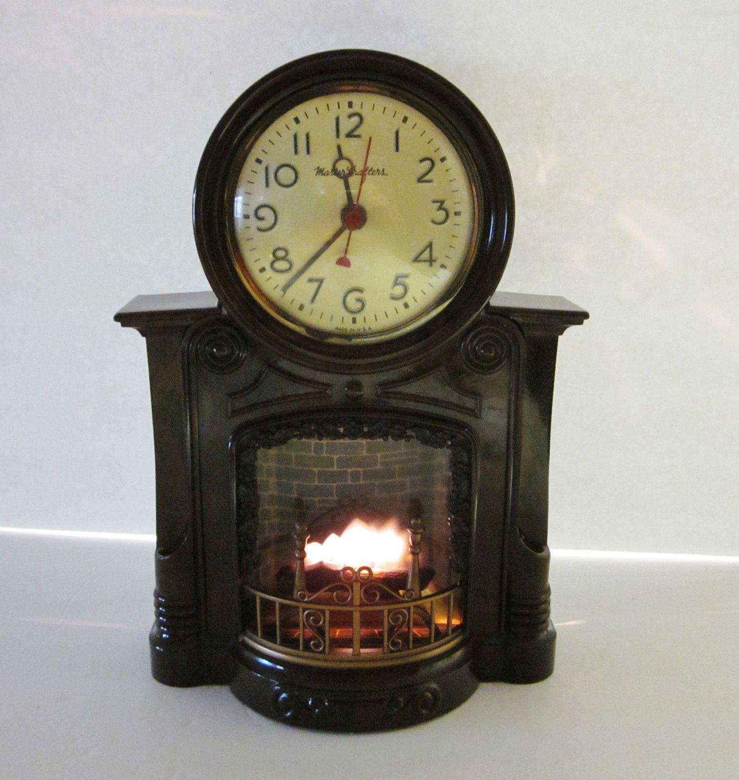 vintage mastercrafters bakelite fireplace motion clock plastic
